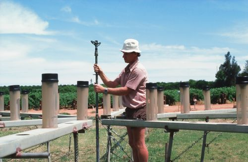 Murray Harvey operating the sprinkler wetting pattern test rig, Loxton Research Centre 1984